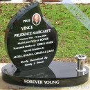 angled tear on oval base headstone